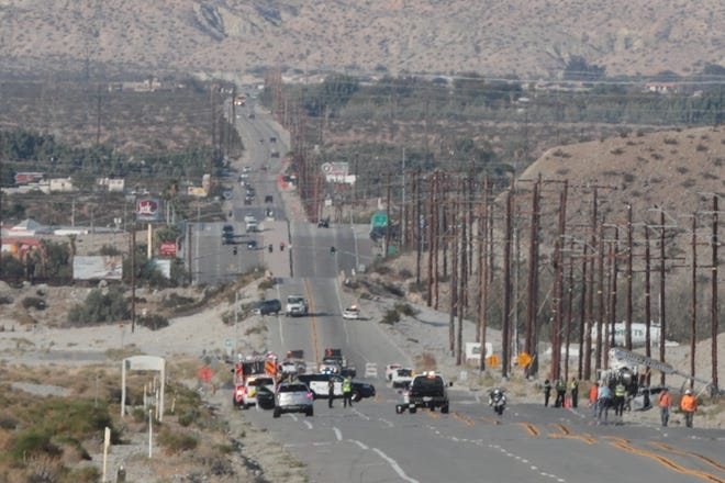 The scene on Indian Canyon Drive that was shut down after a crash that killed a driver and and another person.