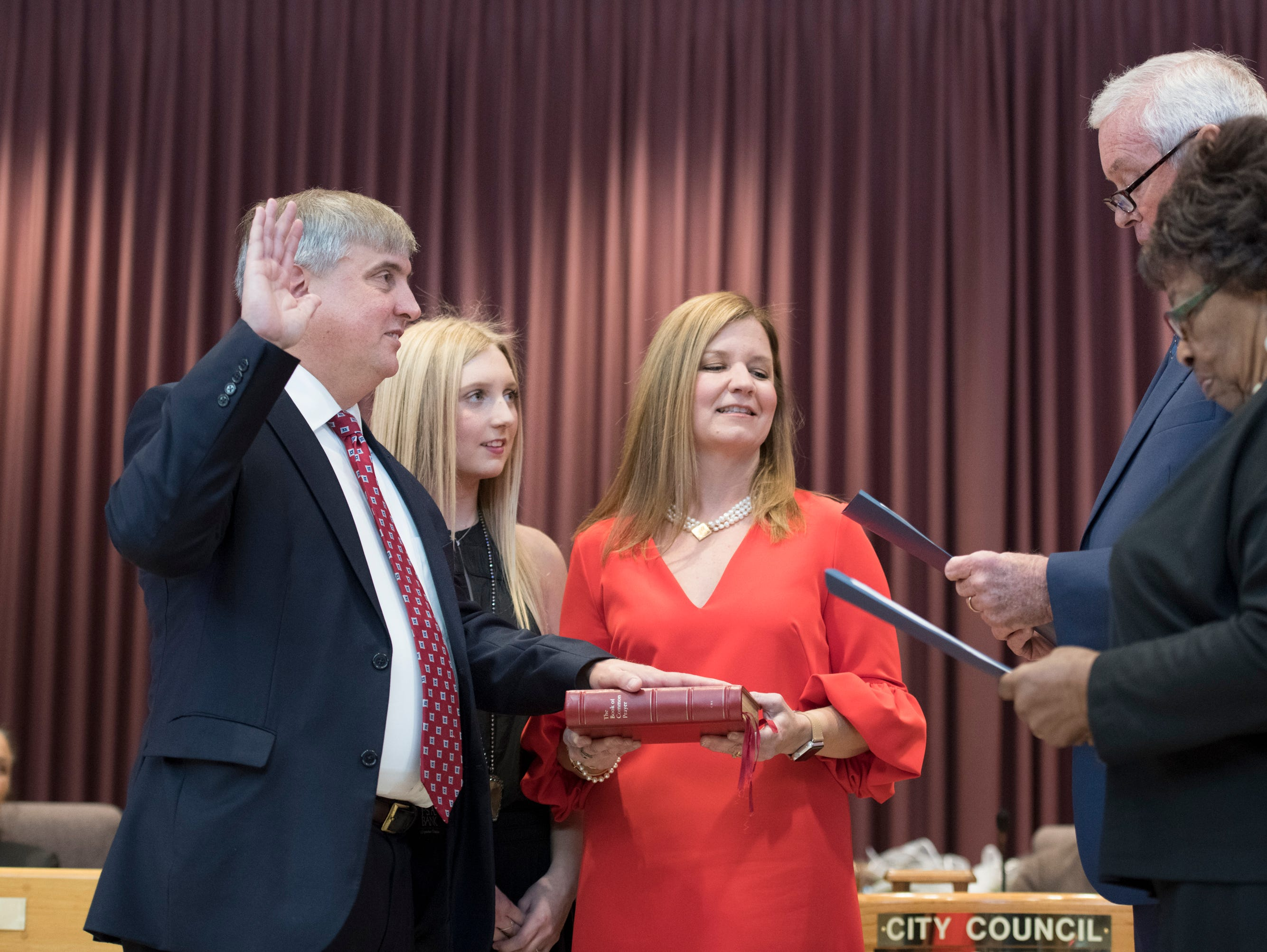 Mayor Grover Robinson is sworn in during the installation ceremony at City Hall in Pensacola on Tuesday, November 27, 2018.