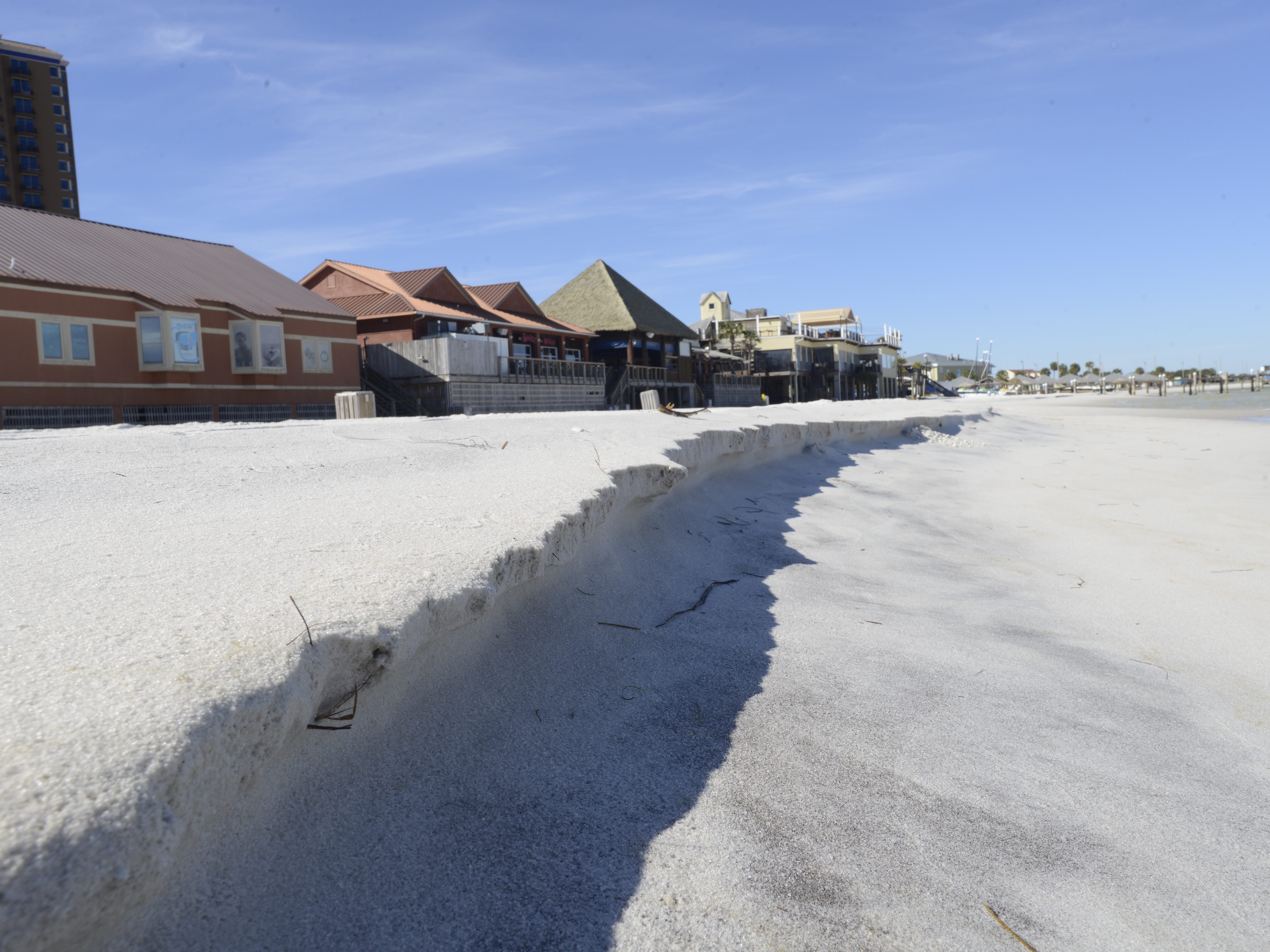 Beach leaders plan to widen Little Sabine and use spoils to renourish Quietwater Beach, the busy beach area behind the Boardwalk Shopping Center.