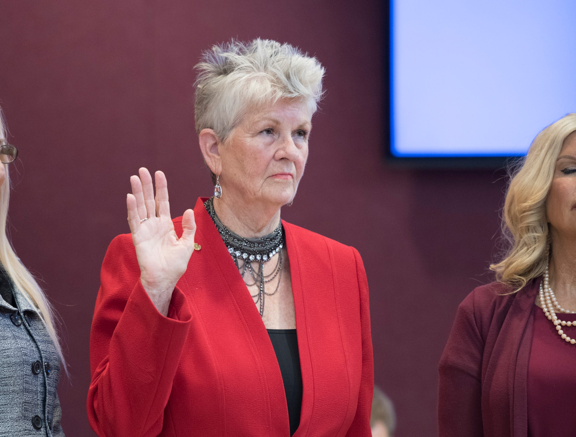 Newly re-elected council member Sherri Myers raises her hand as she is sworn in during the Pensacola City Council installation ceremony at City Hall in Pensacola on Tuesday, November 27, 2018.