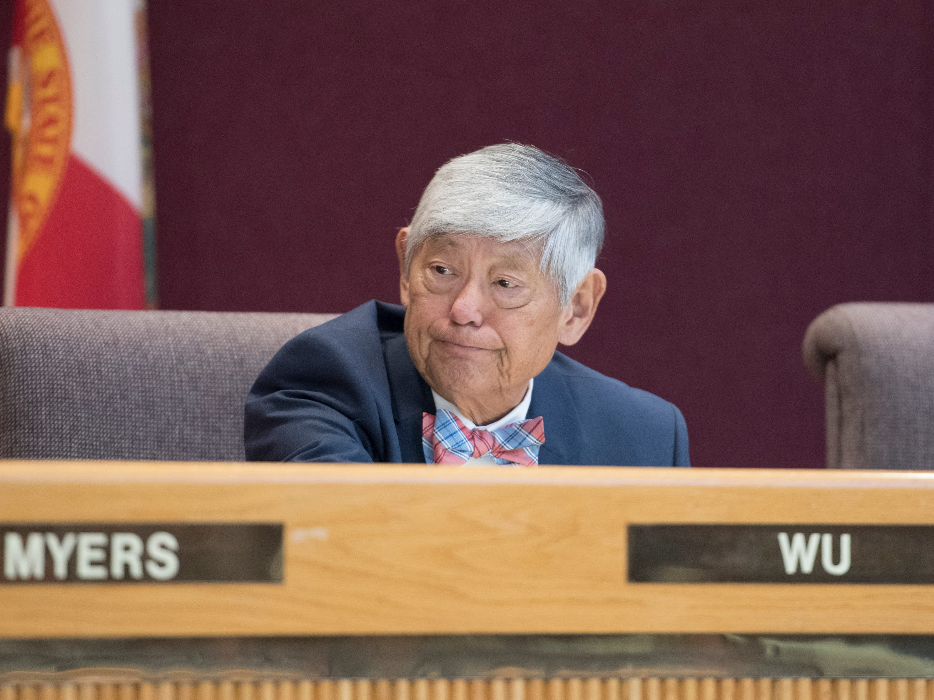 Council member P.C. Wu listens during the Pensacola City Council and Mayor installation ceremony at City Hall in Pensacola on Tuesday, November 27, 2018.