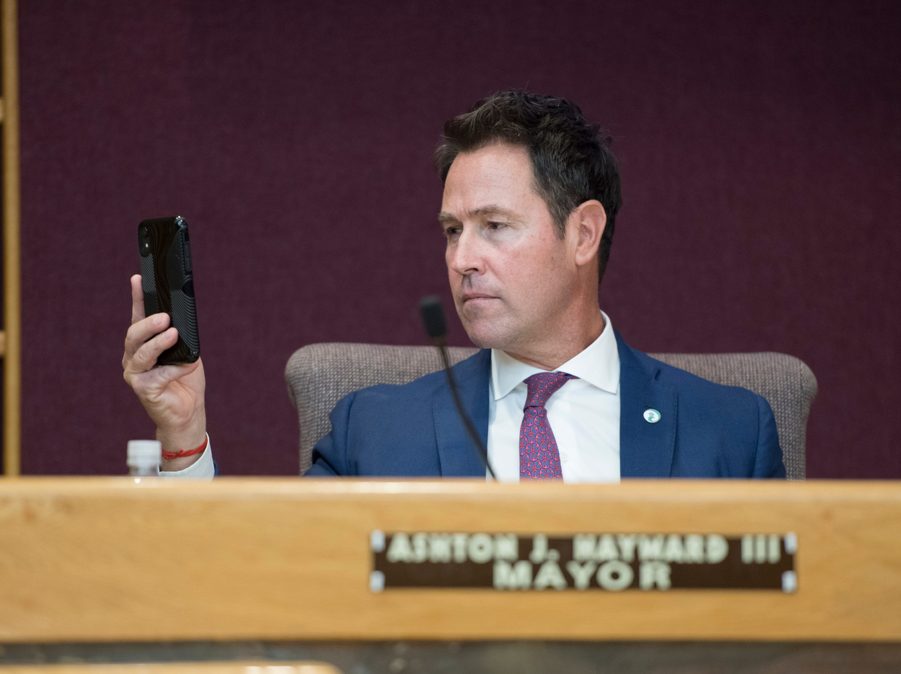 Outgoing Mayor Ashton Hayward snaps some photos prior to the Pensacola City Council and Mayor installation ceremony at City Hall in Pensacola on Tuesday, November 27, 2018.