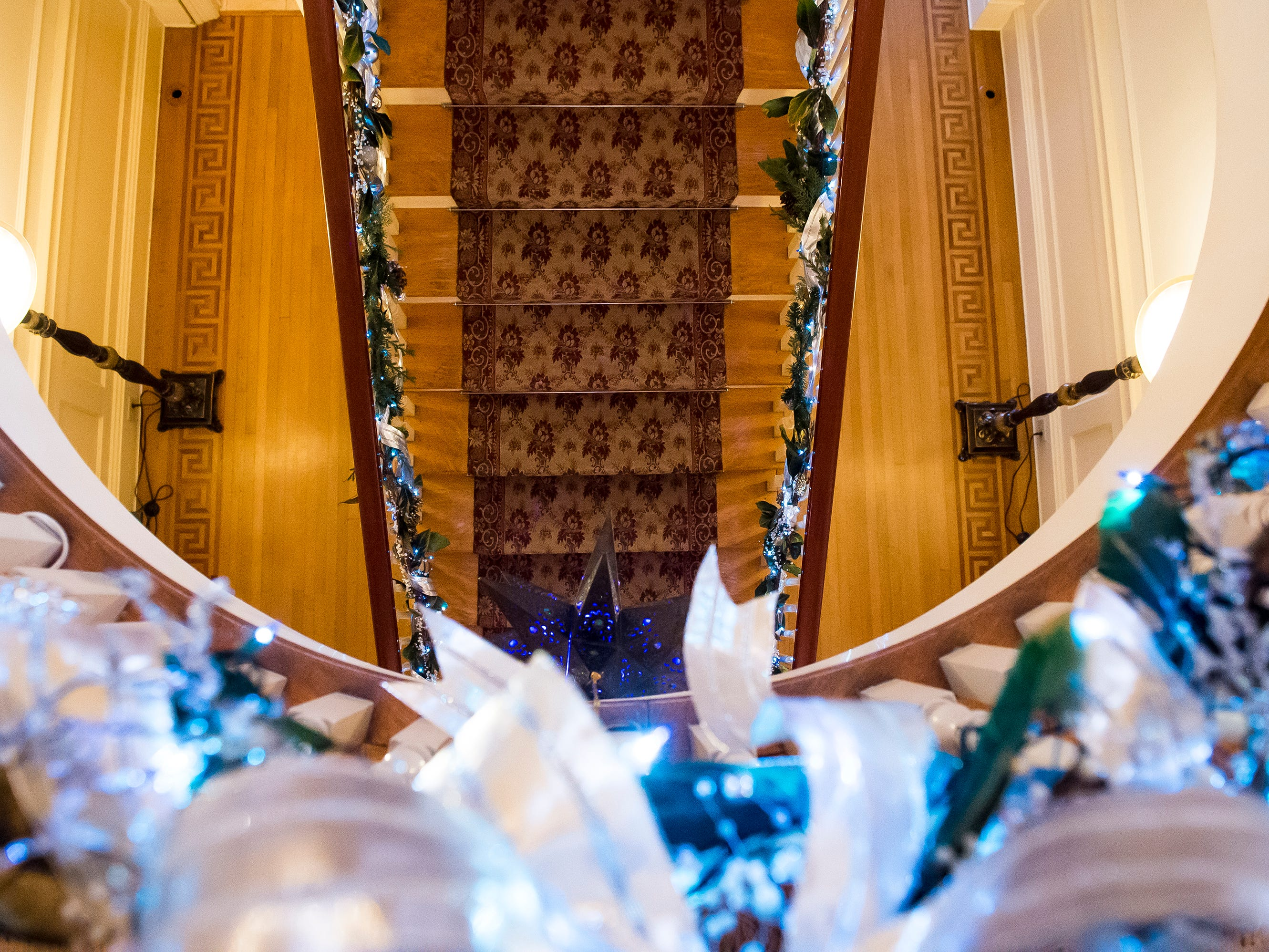 As seen from above, lights and holiday decorations adorn the railings of the grand staircase at the Warehime-Myers Mansion in Hanover. Tree tours are currently being offered and a schedule can be found on the Hanover Area Historical Society's Facebook page.
