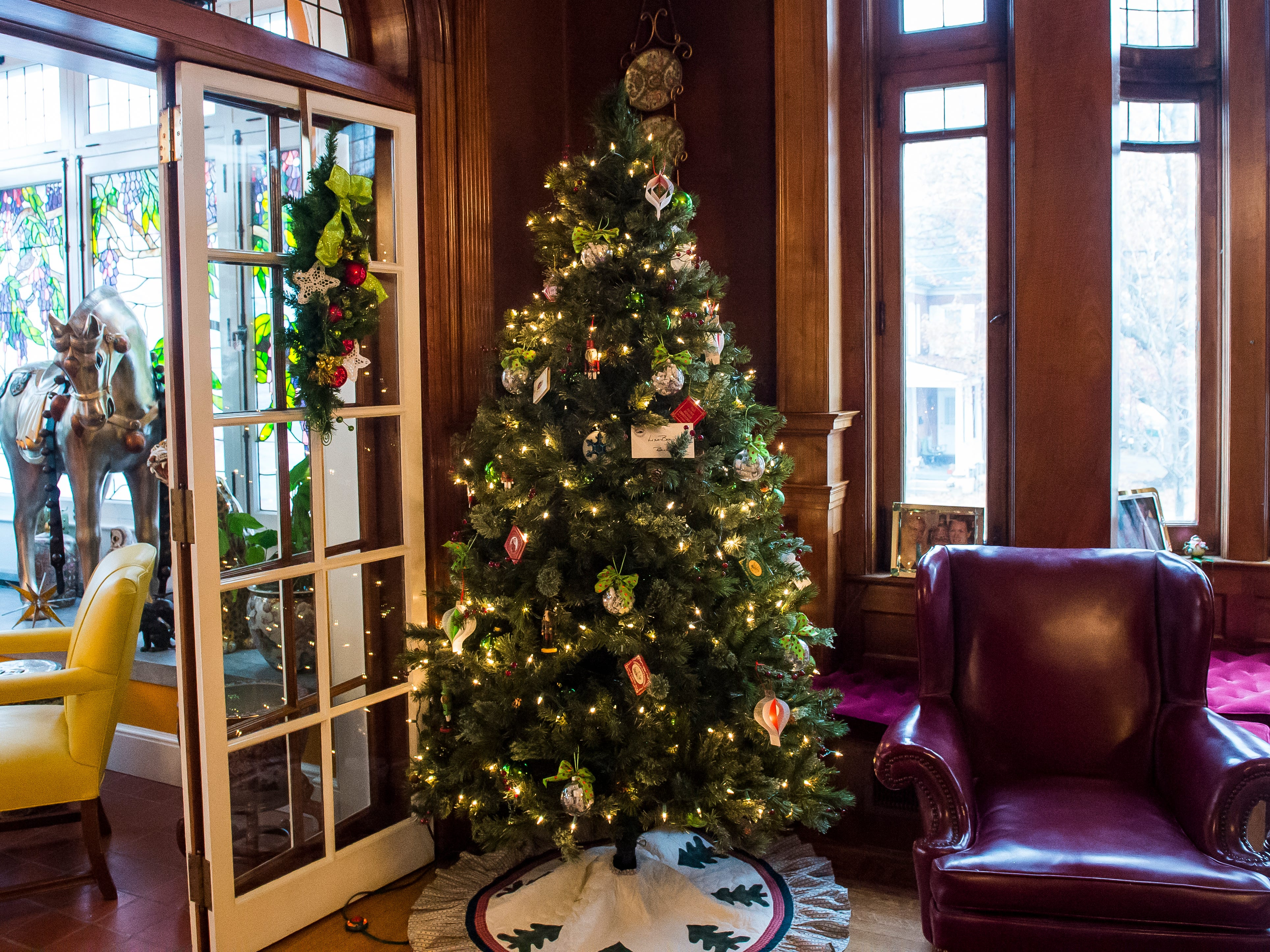 A book-themed tree is displayed in the library room of the Warehime-Myers Mansion in Hanover.