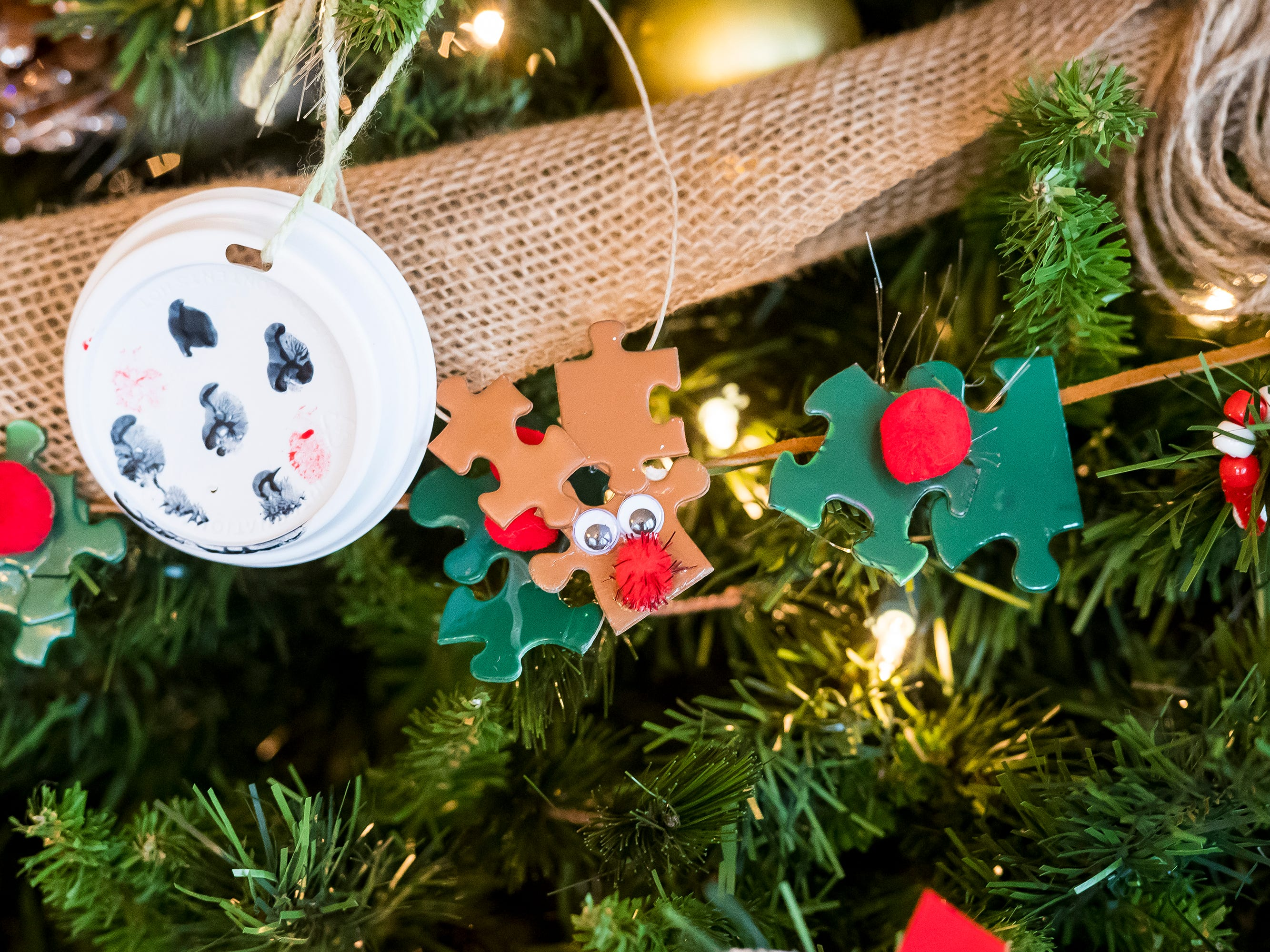 Christmas tree decorations created by children at the Amazing Kids Clubs in Hanover and Red Lion adorn a tree at the Warehime-Myers Mansion in Hanover.