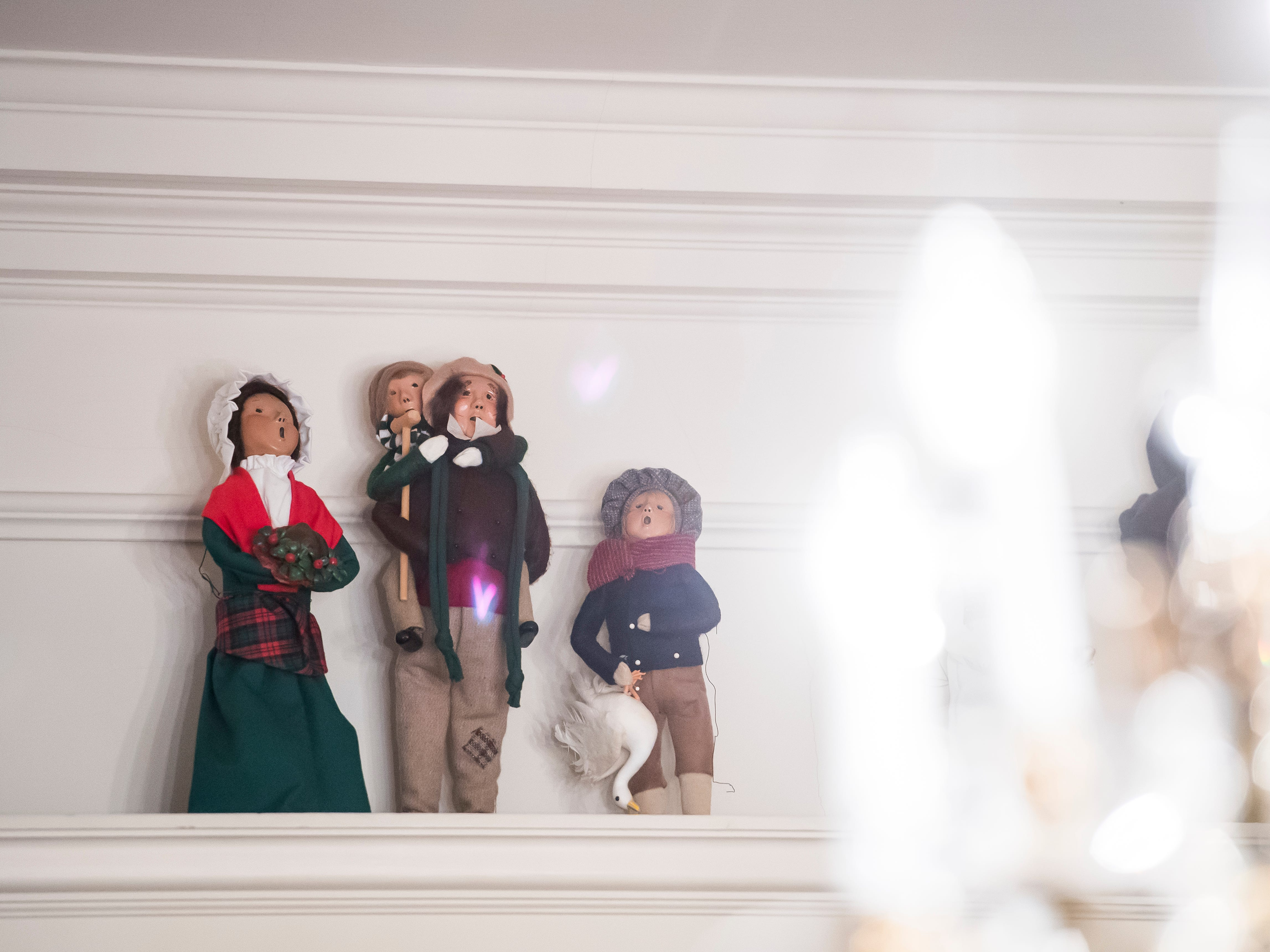 "Figurines from Charles Dickens' ""A Christmas Carol"" sit on a ledge above a doorway at the Warehime-Myers Mansion in Hanover. The figures belong to James Schuman, a past president of the Hanover Area Historical Society and a steward of the mansion."