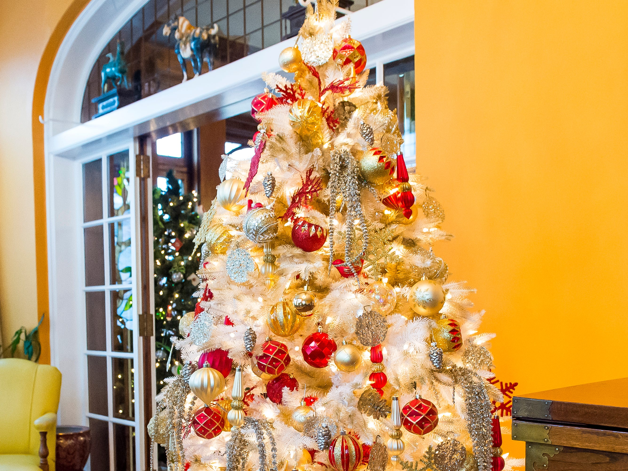 Sandy Woods decorated this Christmas tree that is displayed in the garden room of the Warehime-Myers Mansion in Hanover.