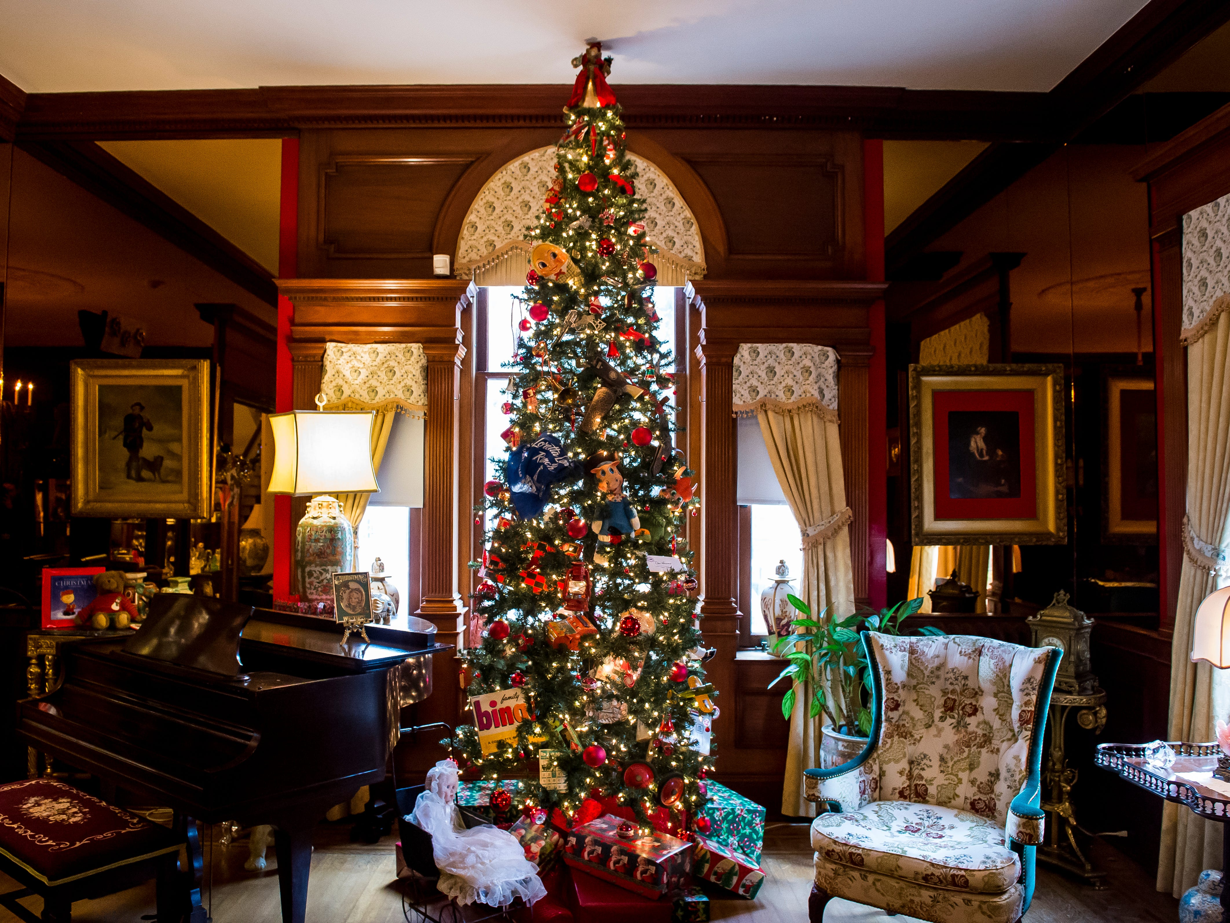 Over 40 decorated Christmas trees are on display at the Warehime-Myers Mansion in Hanover including this 12 foot tree that was decorated by Hanover Area Historical Society board member Don Hamme.