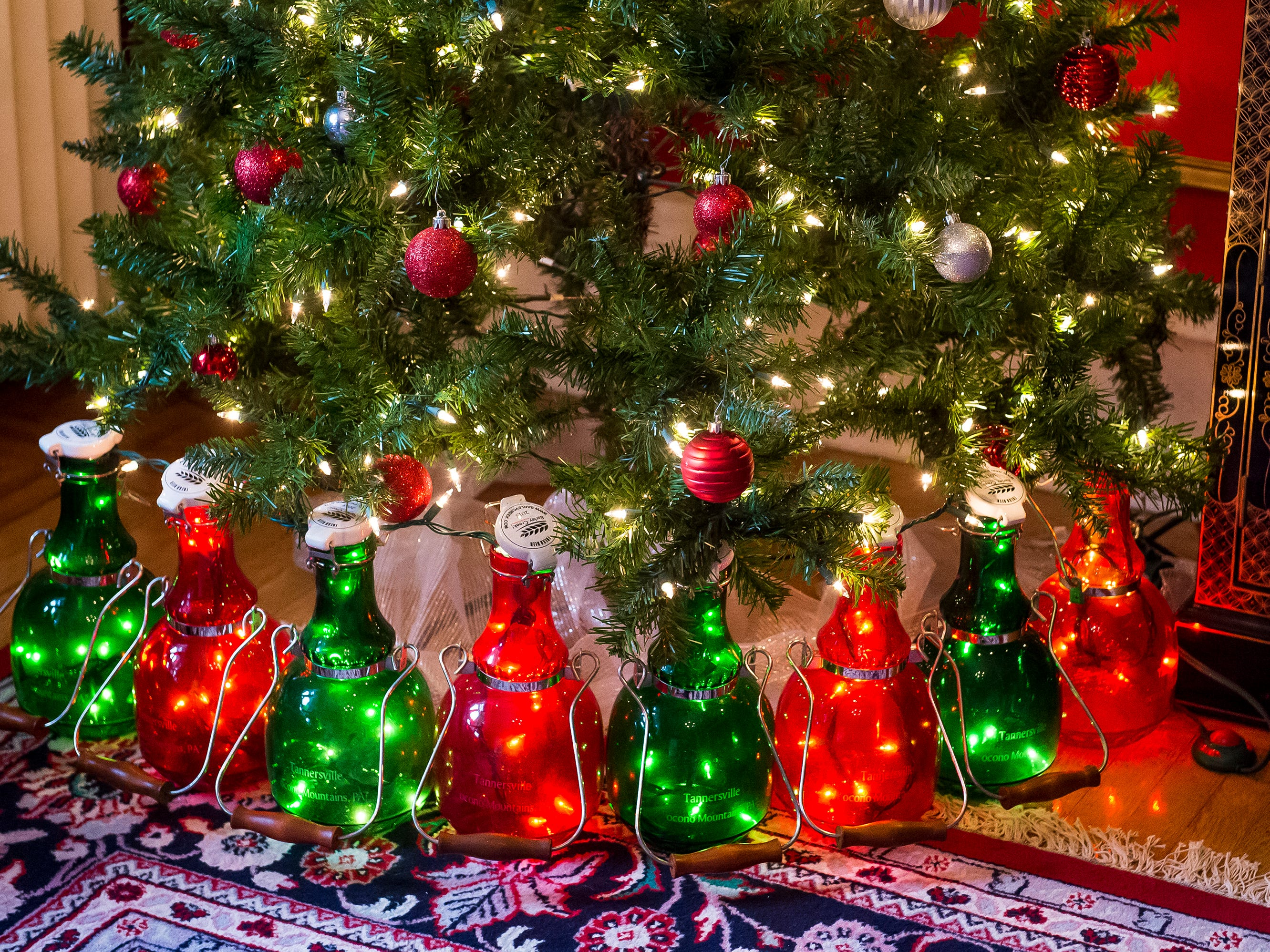 Growlers line the bottom of a Christmas trees decorated by Something Wicked at the Warehime-Myers Mansion in Hanover. Tree tours are currently being offered and a schedule can be found on the Hanover Area Historical Society's Facebook page.