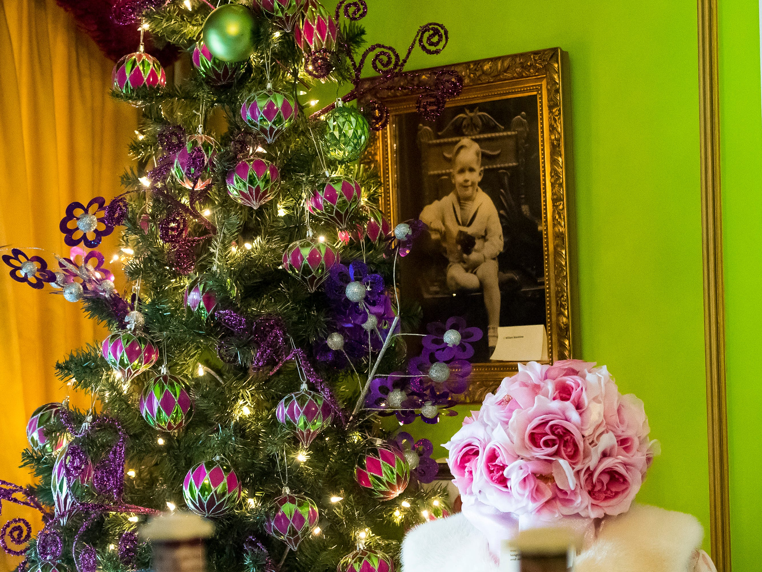 The South Western High School Key Club decorated this tree in the Warehime room at the Warehime-Myers Mansion in Hanover. A portrait of Bill Warehime as a child hangs on the wall behind the tree.