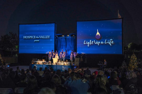 "The ""Light Up a Life"" event at Steele Indian School Park gathered about 1,500 people to share photos and memories of loved ones."