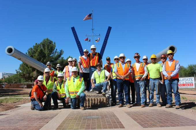 Installation crew at the memorial in Wesley Bolin Plaza. The memorial at Wesley Bolin Memorial Plaza at the Arizona State Capitol, was  dedicated in 2013 and honors Pearl Harbor military personnel and World War II veterans.