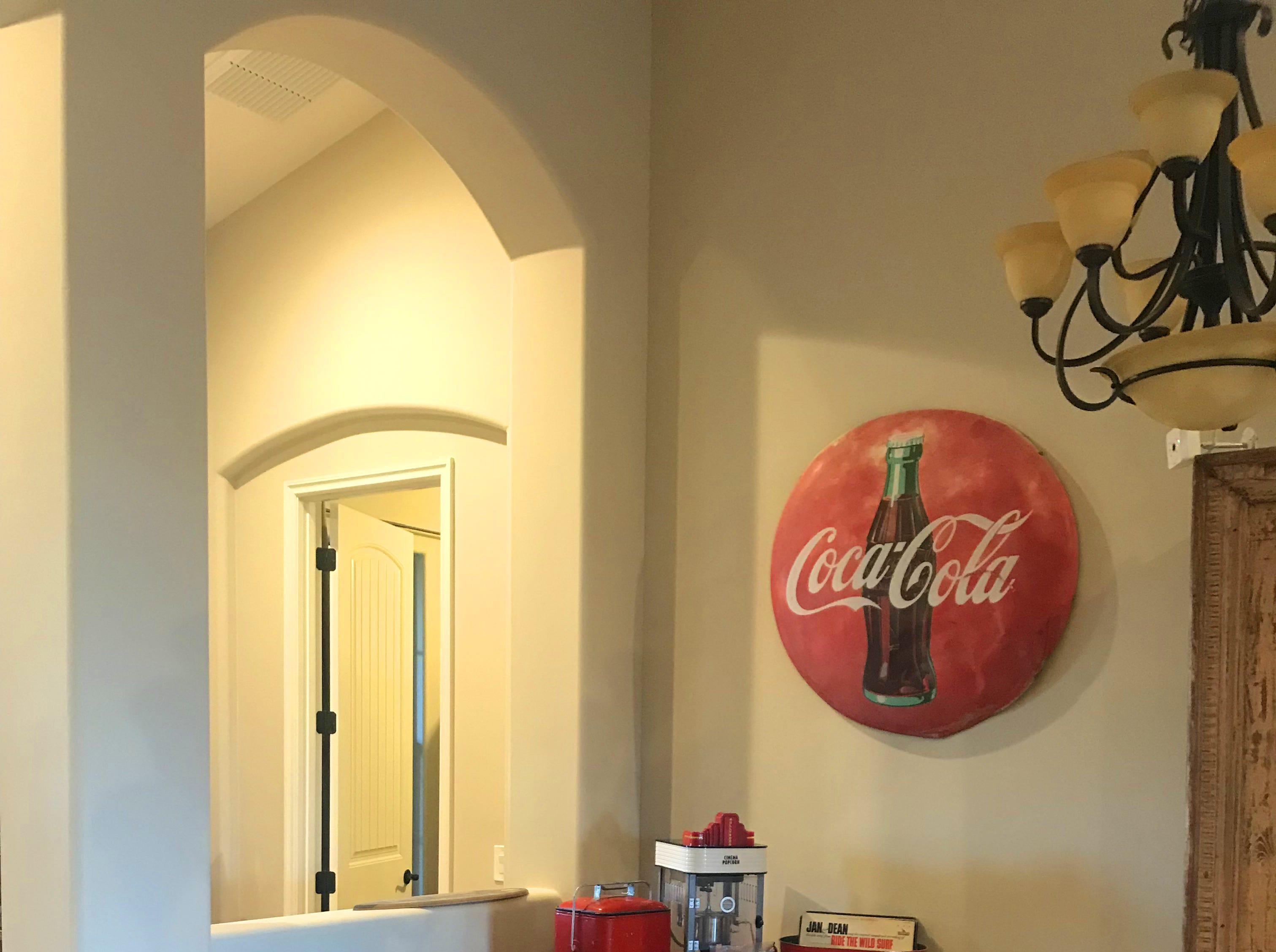 Shelley's vintage Coca-Cola collection includes a functioning vending machine from the 1950's. The top spins and opens enough for one bottle to be removed when a dime is inserted.