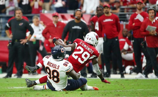 Chase Edmonds is tackled for a loss by Bears defensive end Bilal Nichols on a third down during the Cardinals' 16-14 loss to Chicago at State Farm Stadium.