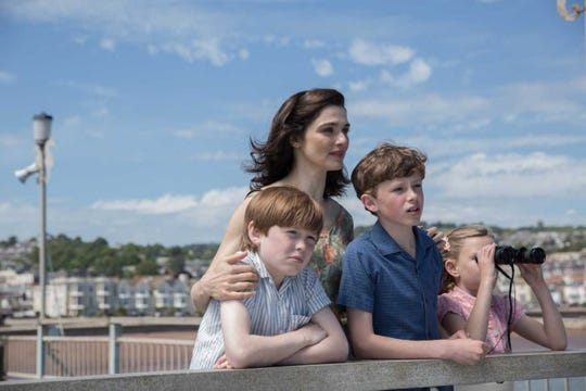 "Clare Crowhurst (Rachel Weisz) stands with her children, from left to right, Simon (Kit Connor), James (Finn Elliot) and Rachel (Eleanor Stagg) in ""The Mercy."""
