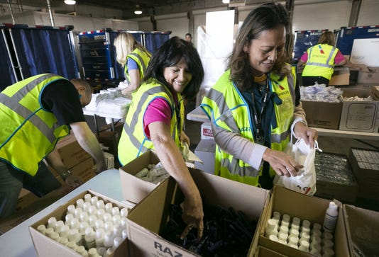 American Airlines employees pack kits for California wildfire victims
