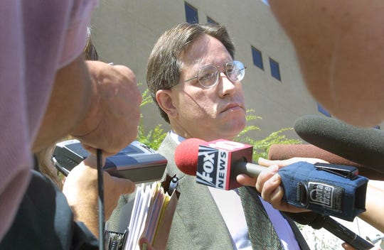 Mark Salerno talks to the media following his 2002 preliminary hearing in Mesa for auto-theft charges filed against him.
