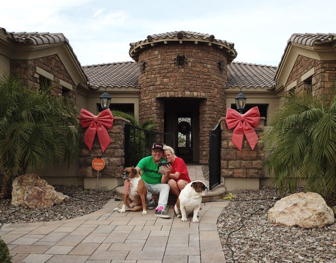 Jeff and Shelley Jones with their dogs Zoe and Hank. Jeff is a manufacturers' representative for electrical building products. Shelley is employed at Cozy Corner cafe.