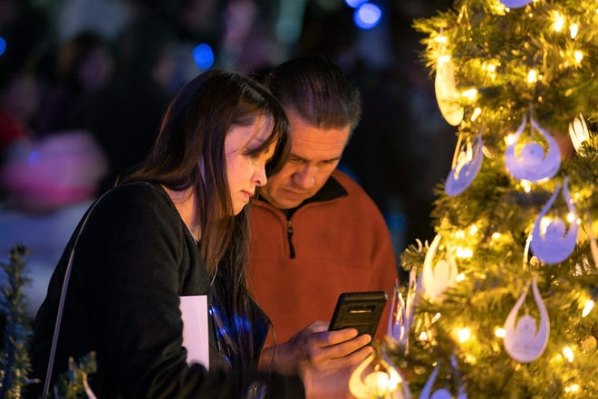 People gathered at Steele Indian School Park to remember loved ones.