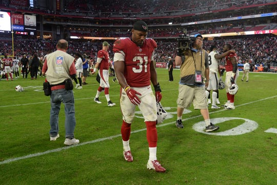 Cardinals running back David Johnson leaves the field after a last-second loss to the Raiders on Nov. 18 at State Farm Stadium.