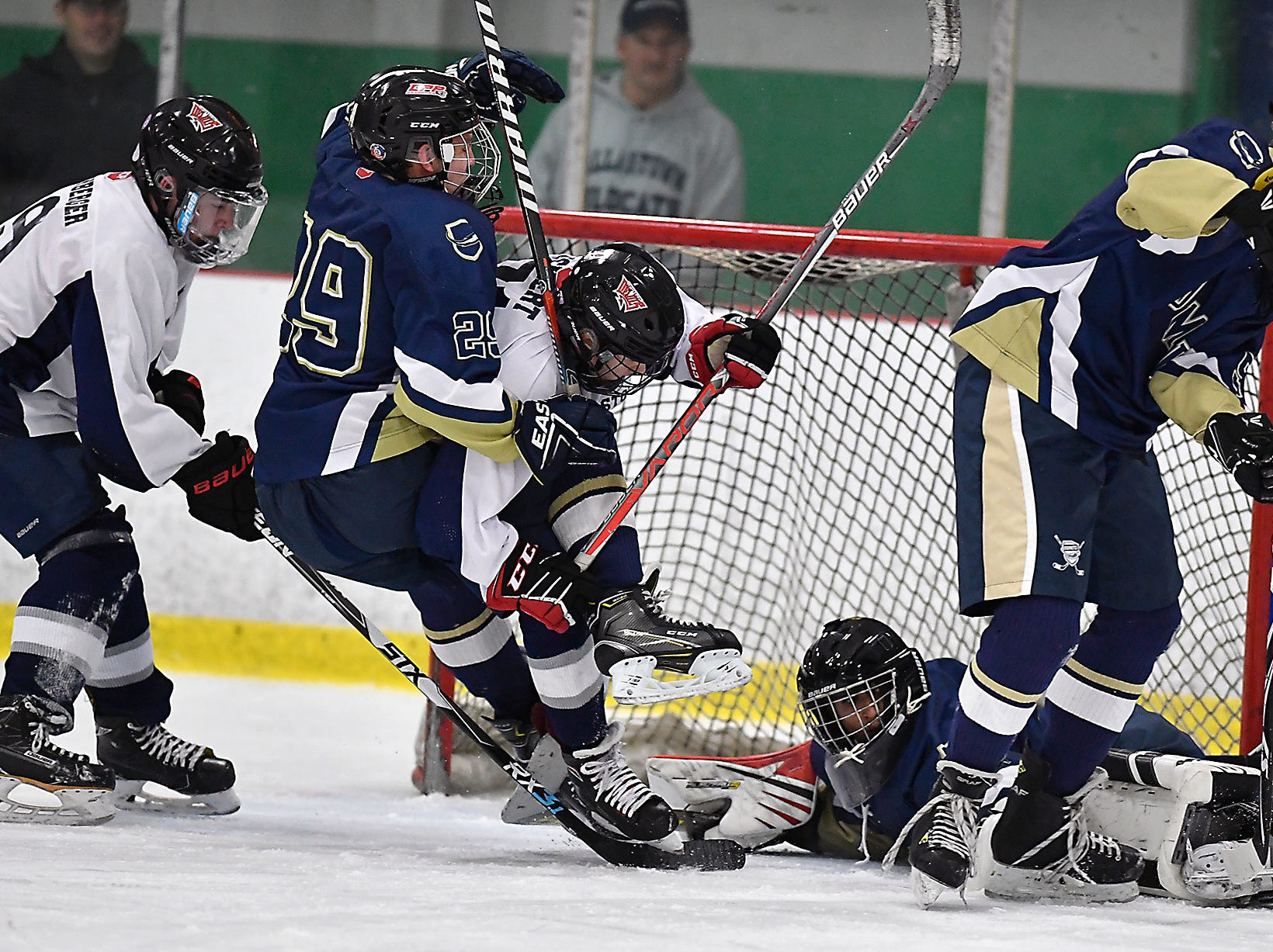 Jake Jesberger of Penn Manor and Quinn Eckert of Dallastown get tangled up in front of the Dallastown goal, Monday, November 26, 2018.John A. Pavoncello photo