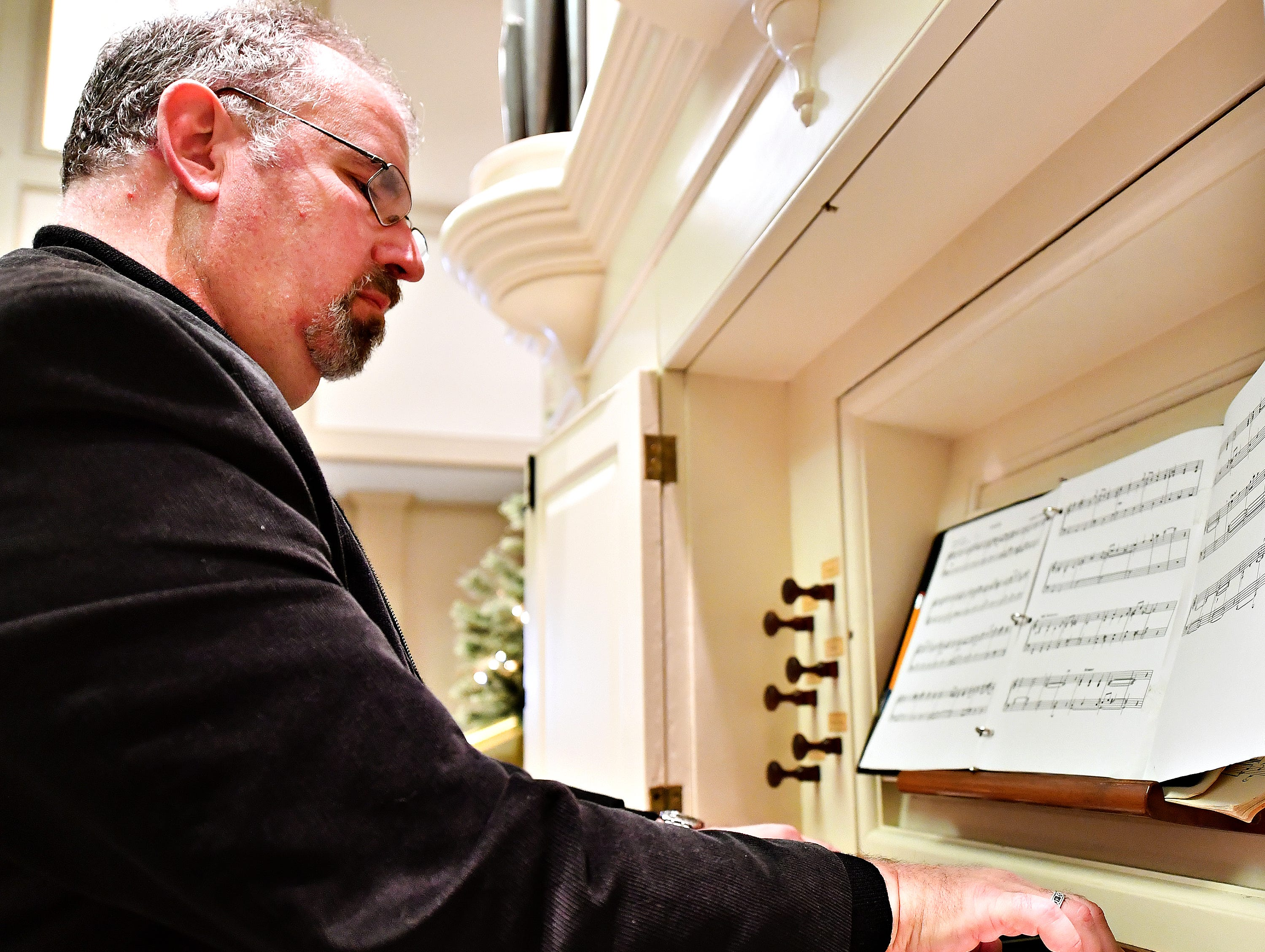 Victor Fields, of Springfield Township, plays the David Tannenberg Organ during a free performance on Giving Tuesday at York County History Center in York City, Tuesday, Nov. 27, 2018. Dawn J. Sagert photo
