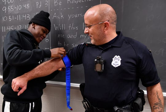 William Penn Senior High School Public Safety and Emergency Services student Steve Prince, left, applies a tourniquet to School Police Officer Bryan Einsig during a Stop the Bleed class, Tuesday, Nov. 27, 2018.  John A. Pavoncello photo