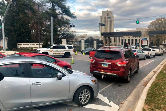 """Cars are prevented from entering or exiting the Walter Reed National Military Medical Center, Tuesday, Nov. 27, 2018 in Bethesda, Md. Security officers found """"no indication"""" of an active shooter after reports from Walter Reed National Military Medical Center outside Washington, officials said Tuesday.Naval Support Activity Bethesda tweeted at 2:15 p.m. that an active shooter had been reported in the basement of a building at the Maryland base. (AP Photo/Michael Kunzelman)"""