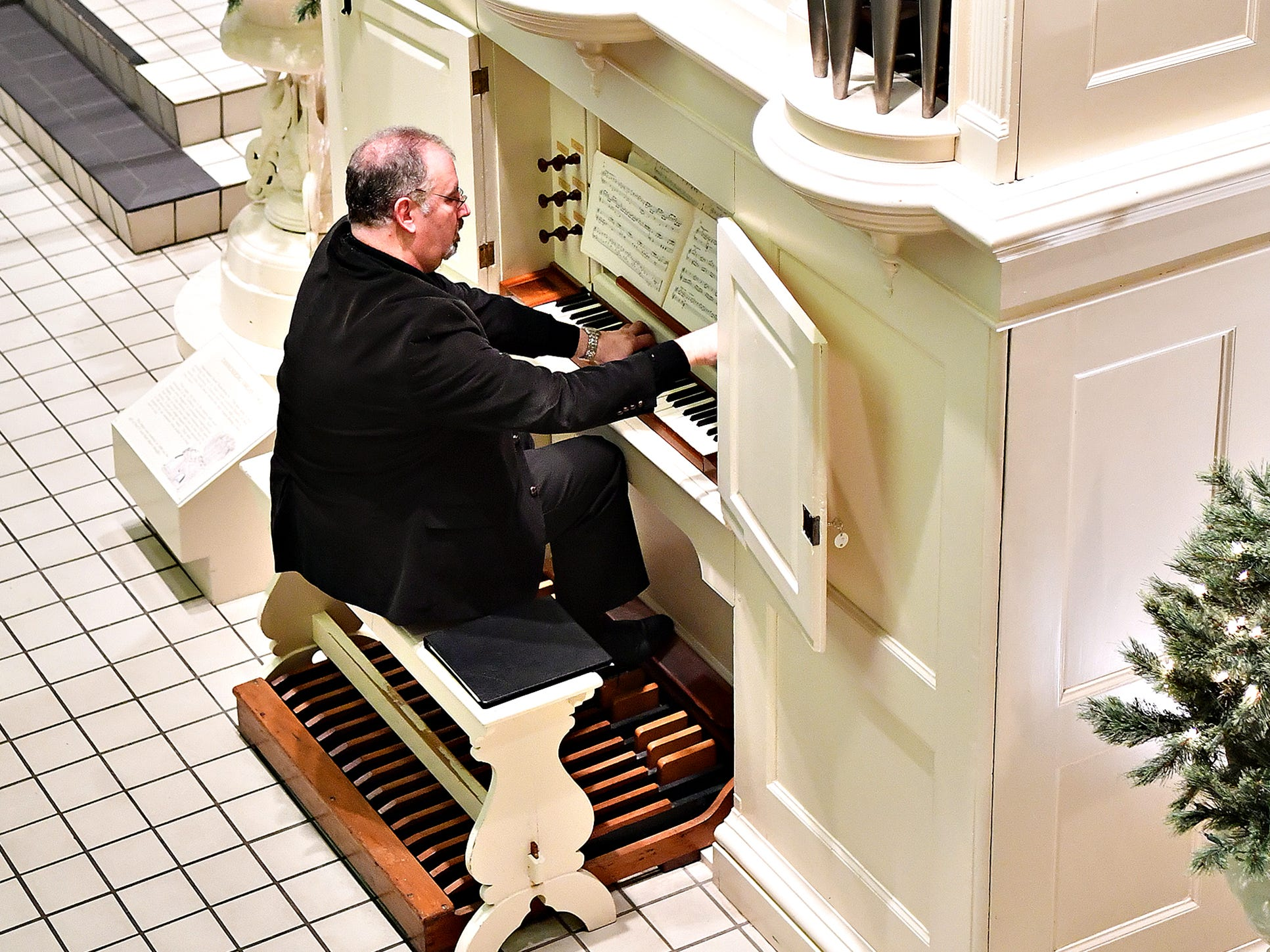 Victor Fields, of Springfield Township, plays the David Tannenberg Organ during a free performance and fundraising campaign launch on Giving Tuesday at York County History Center in York City, Tuesday, Nov. 27, 2018. The history center is hoping to raise $250,000 for the restoration of the 1804 Tannenberg organ. Dawn J. Sagert photo