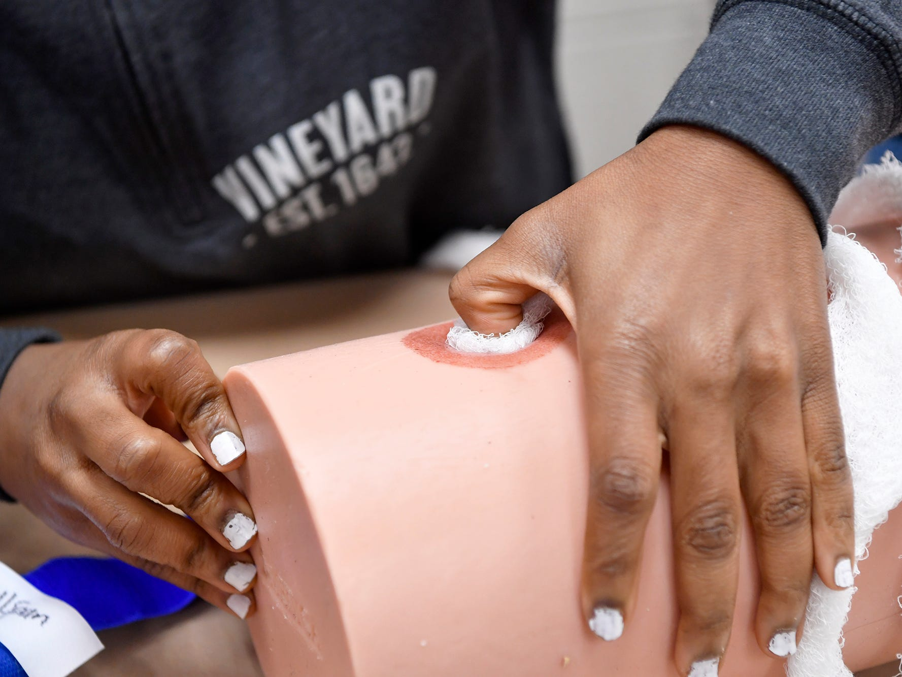 """Students in the William Penn Senior High School Public Safety and Emergency Services class learn how to """"stop the bleed"""" during class, Tuesday, November 27, 2018. John A. Pavoncello photo"""