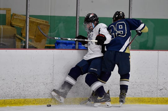 Dallastown's Camden Schanberger, left, had a hat trick in a 6-3 win over Manheim Central on Monday night. DISPATCH FILE PHOTO.