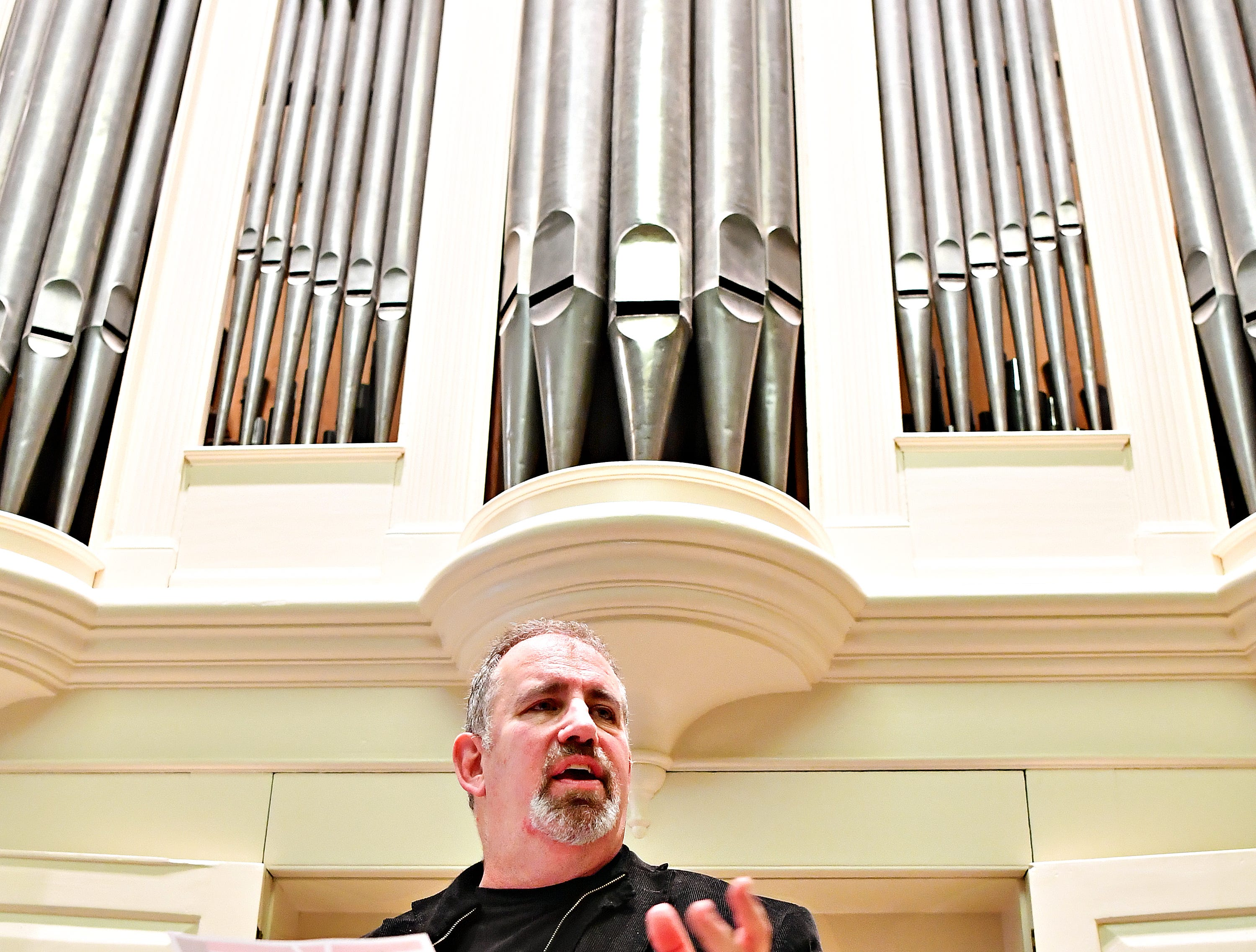 An audience looks on as Victor Fields, of Springfield Township, talks briefly about musical selections during a free performance on Giving Tuesday at York County History Center in York City, Tuesday, Nov. 27, 2018. The history center is hoping to raise $250,000 for the restoration of the 1804 Tannenberg organ. Dawn J. Sagert photo