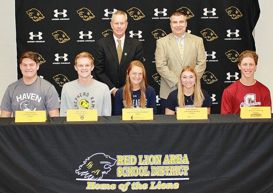 Red Lion seniors recently signed their college letters of intent. Front row, Red Lion seniors Sean Glatfelter, Nate Hodgkinson, Emily Tollinger, Taylor Radziwicz and CJ Czerwinski. Back row, Red Lion athletic director Arnie Fritzius and principal Mark Shue.