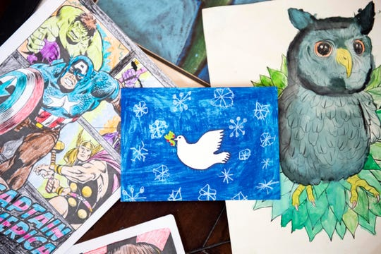 From coloring to painting, 11-year-old Tommy Duffy, of Springettsbury, says he loves the endless possibilities of art. His depiction of a dove flying through snowflakes, pictured center, was one of four winners for Make-A-Wish's annual holiday card design contest. Tommy was diagnosed with a congenital heart disease when he was eight-weeks-old. His Make-A-Wish trip will be to visit The Wizarding World of Harry Potter, in Orlando.