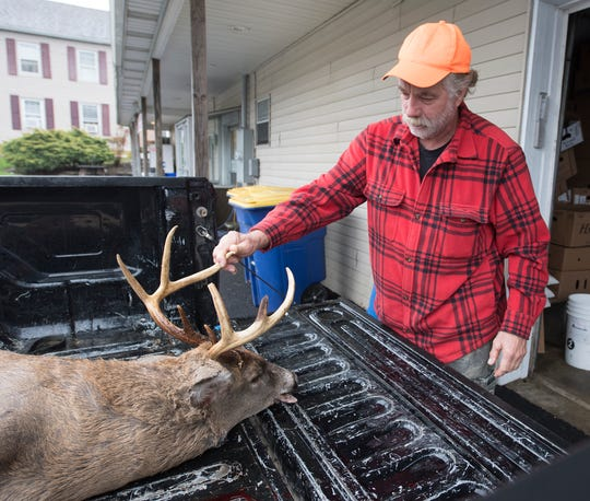 James Harrington Jr. with the 150 pound buck he harvested in Lower Windsor Township.