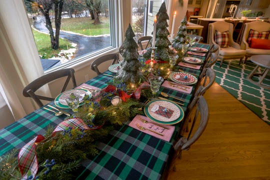 Amie Freling-Brown  uses her nice china mixed with inexpensive plates to add whimsy to her table.