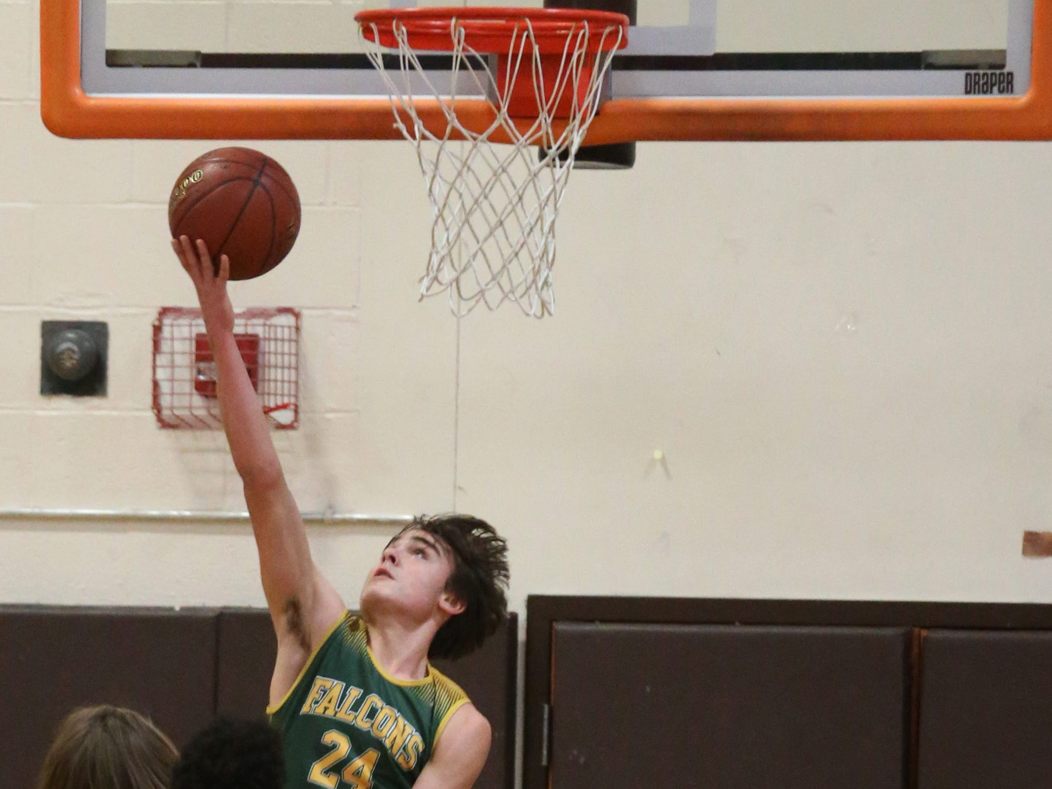 Finney's Keegan Ocorr puts in two on a reverse layup.