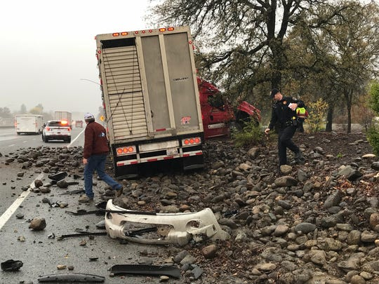 A cattle truck is stuck off Interstate 5 near Oasis Road following a Tuesday collision with a sport utility vehicle.