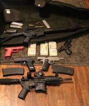 Trinity County sheriff's deputies found guns, pot and cash during the execution of two search warrants.