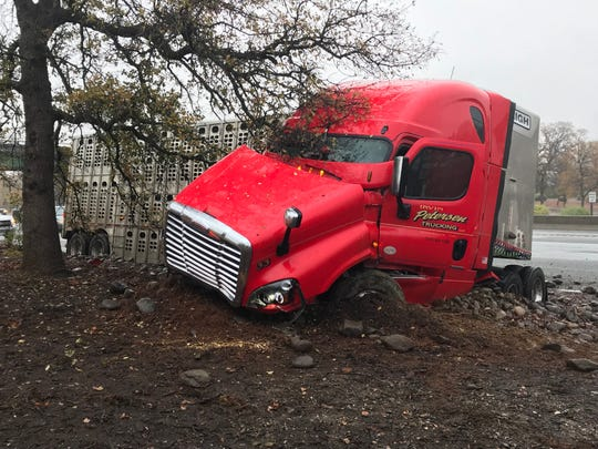 It was going to take a lot of work Tuesday to remove a cattle truck off I-5 near Oasis Road.