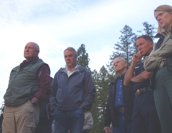 U.S. Secretary of Agriculture Sonny Perdue, left, and Secretary of the Interior, Ryan Zinke, listen to a presentation during a tour of the Camp Fire in Butte County on Monday.