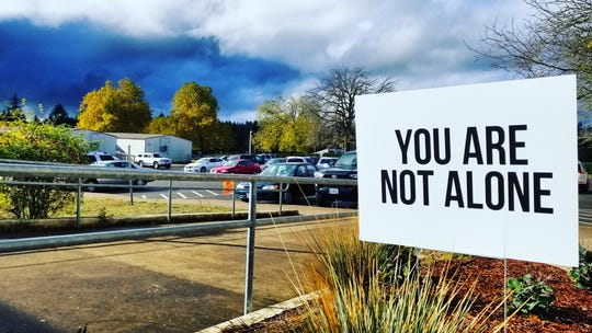 Signs with positive messages can be seen in and around buildings on the campus of Sprague High School in the wake of three student deaths by suicide in eight months.