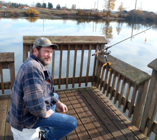 """Deano Lasley joked that he went to Junction City Pond to """"just waste the day away."""""""