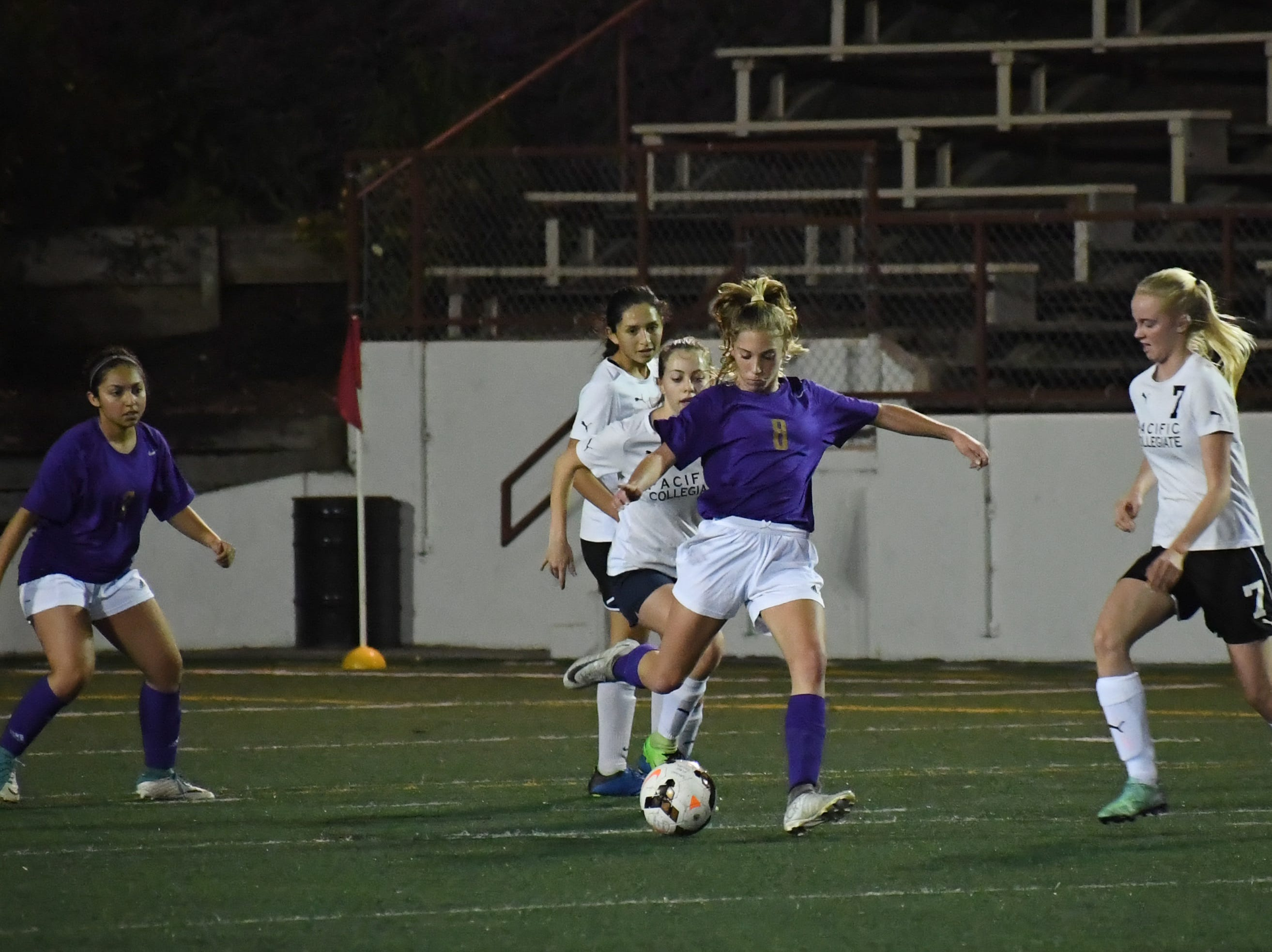 Freshman Taylor Freitas (8) kicks the ball downfield to stop a counterattack.