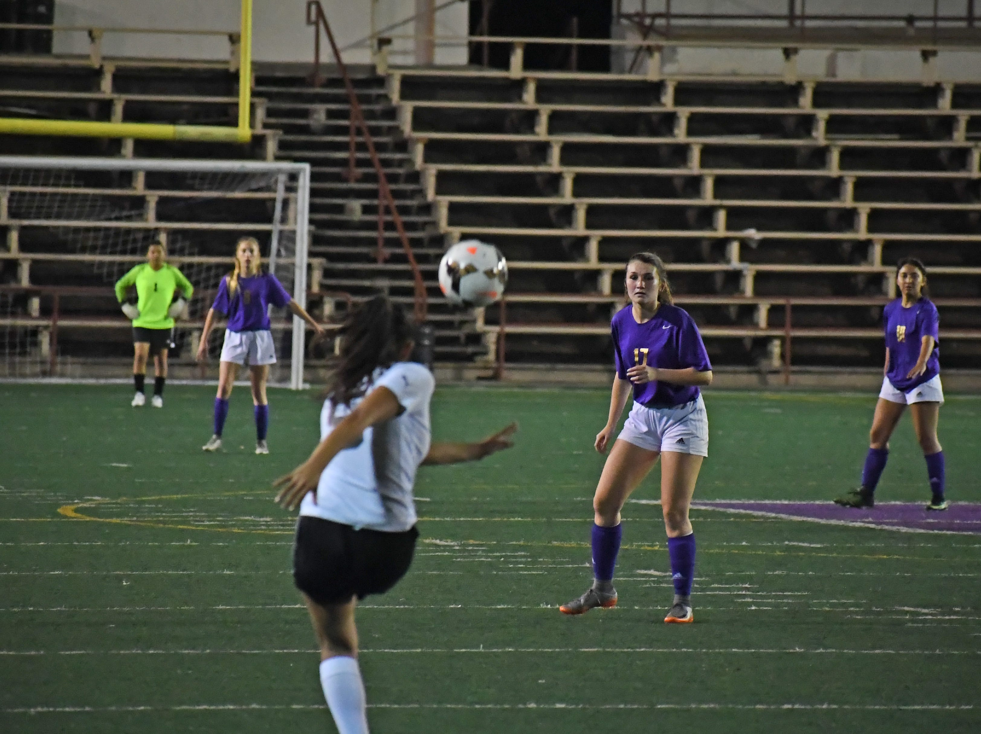 Senior Chloe Thompson (17) waits to chase down the ball after a free kick.
