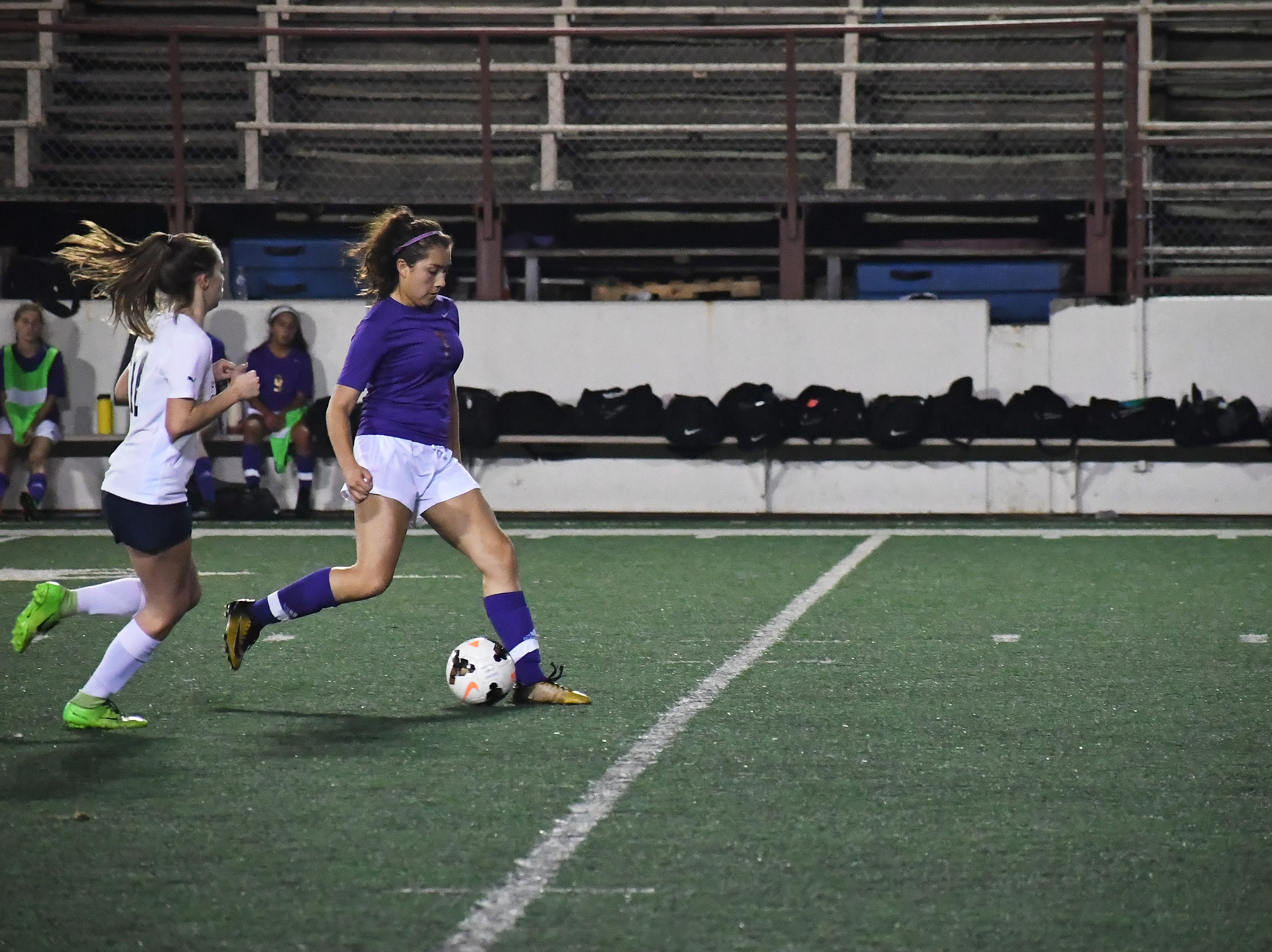 Junior Maria Garcia (7) dribbles past the defense in the second half.