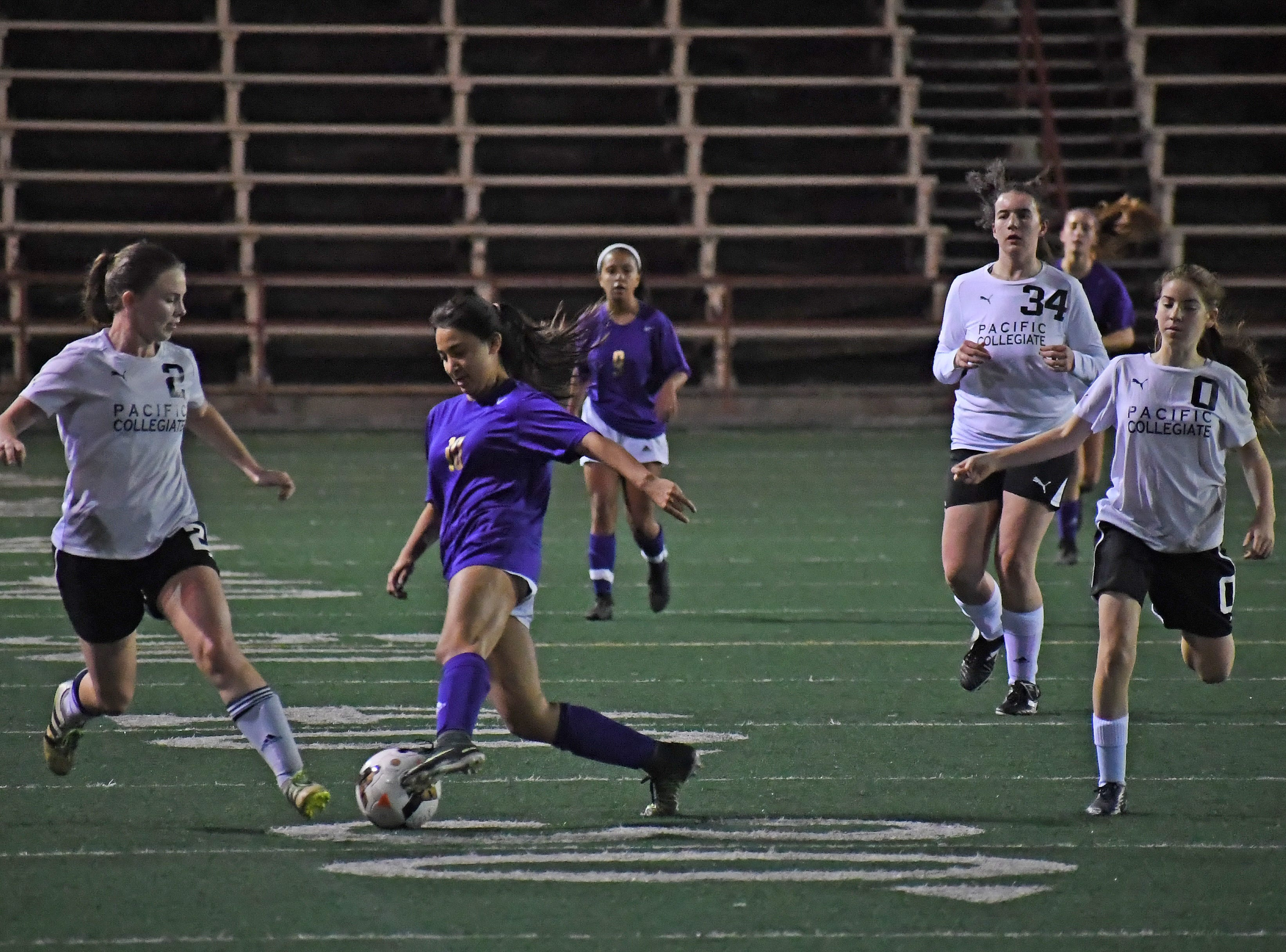 Senior Yadira Acosta (10) cuts to the outside to evade a defender.