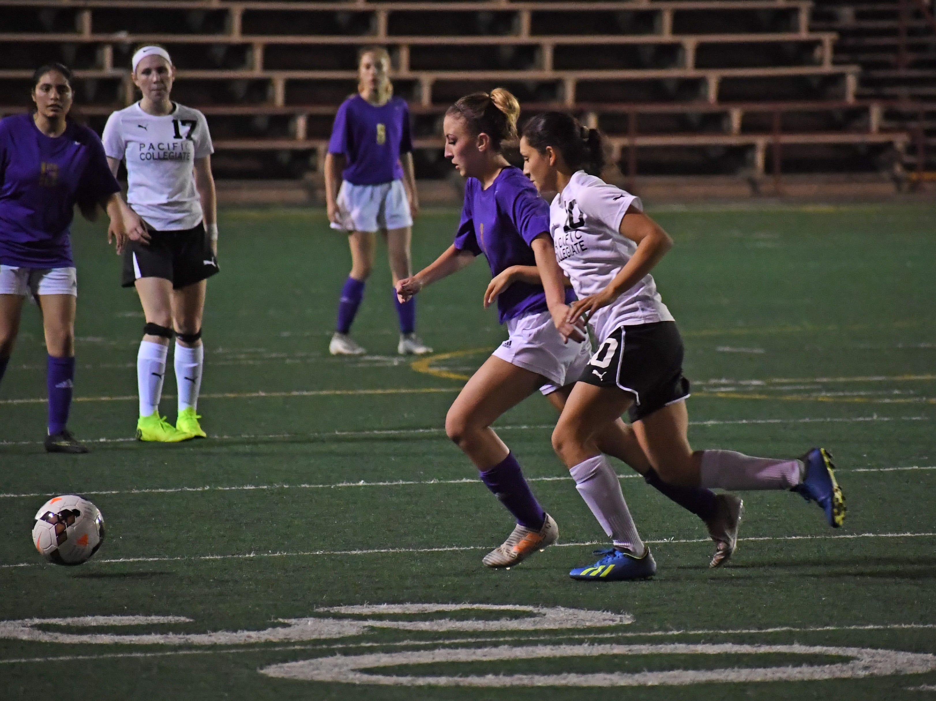 Sophomore Camryn Garcia (3) fights for possession.