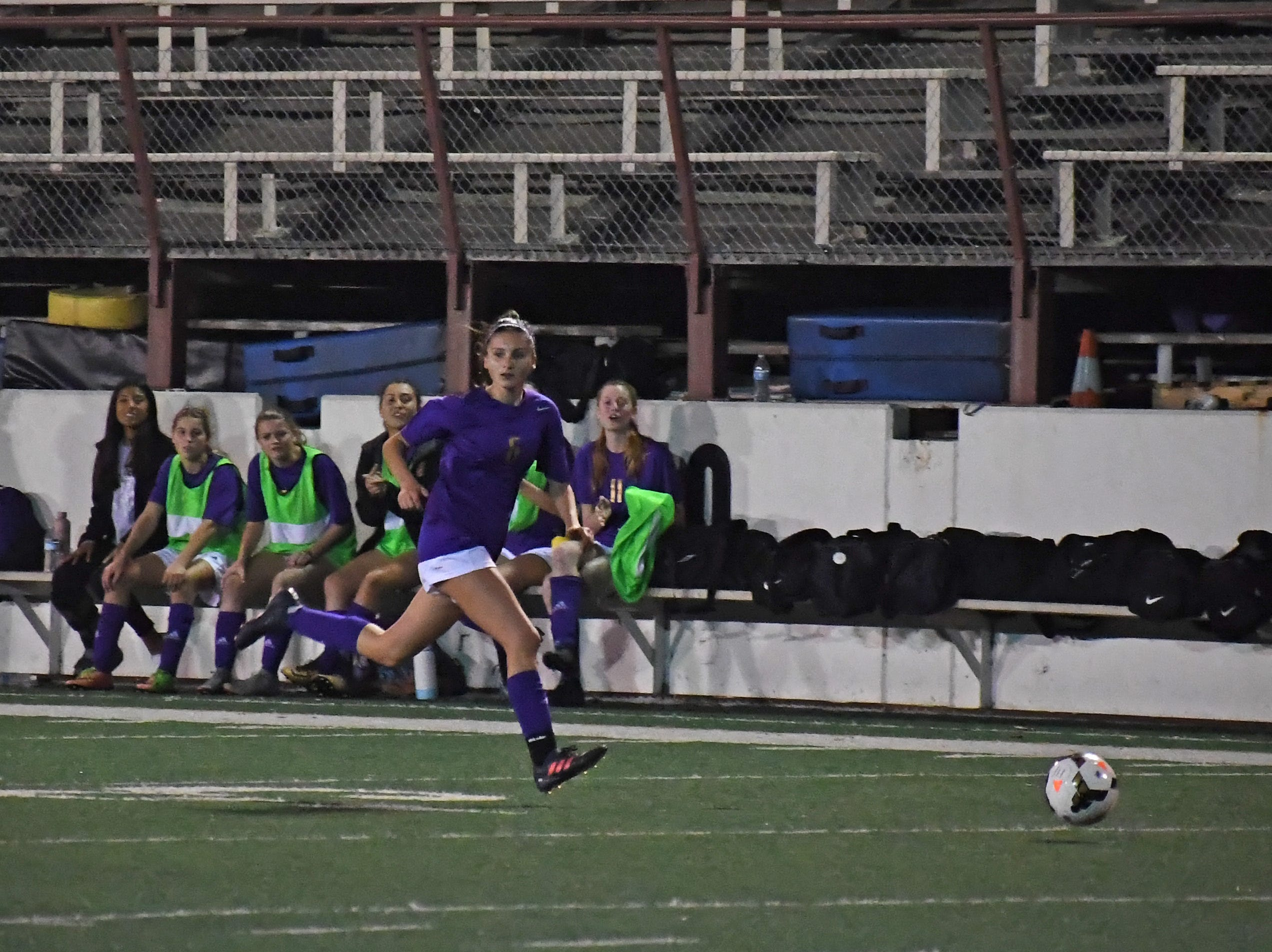 Junior Vivianne Mendoza (6) looks to pass while sprinting downfield.