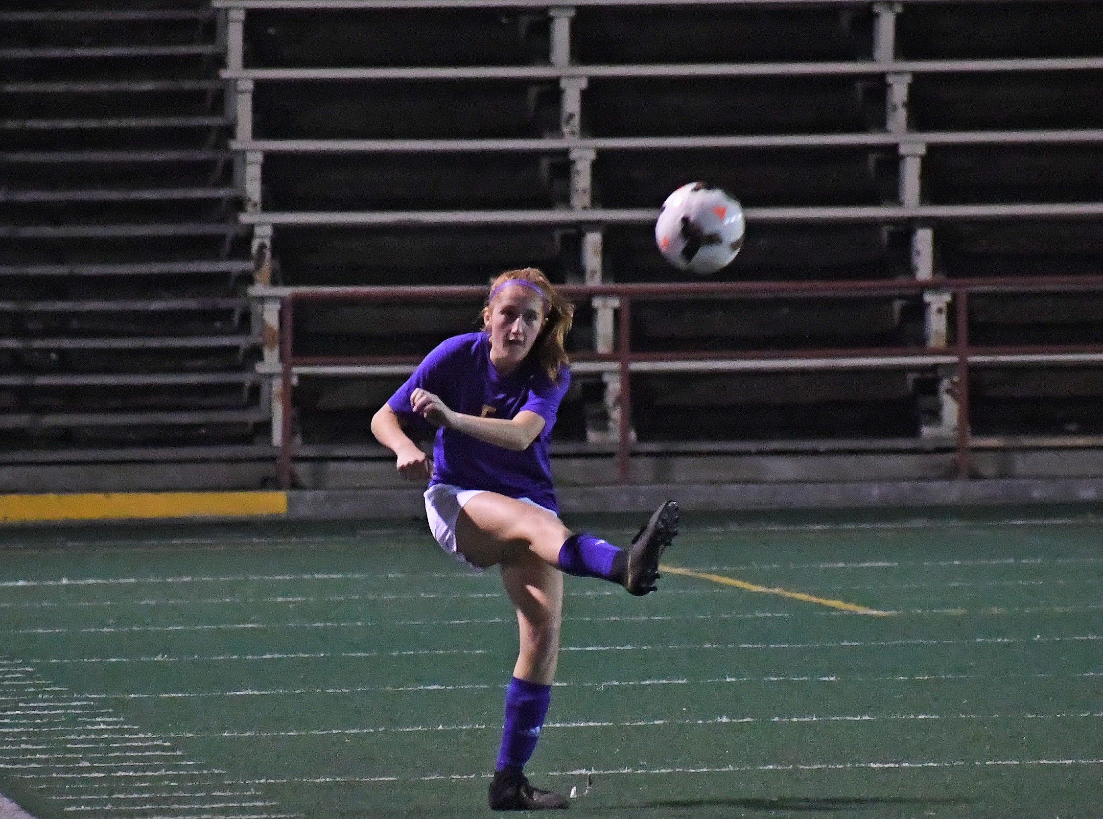Sophomore Isabella Richert (5) fires a pass downfield.